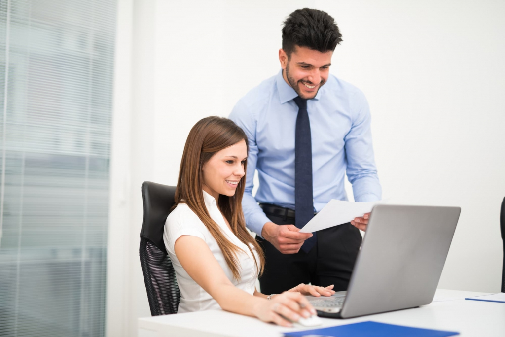 Office workers using laptop